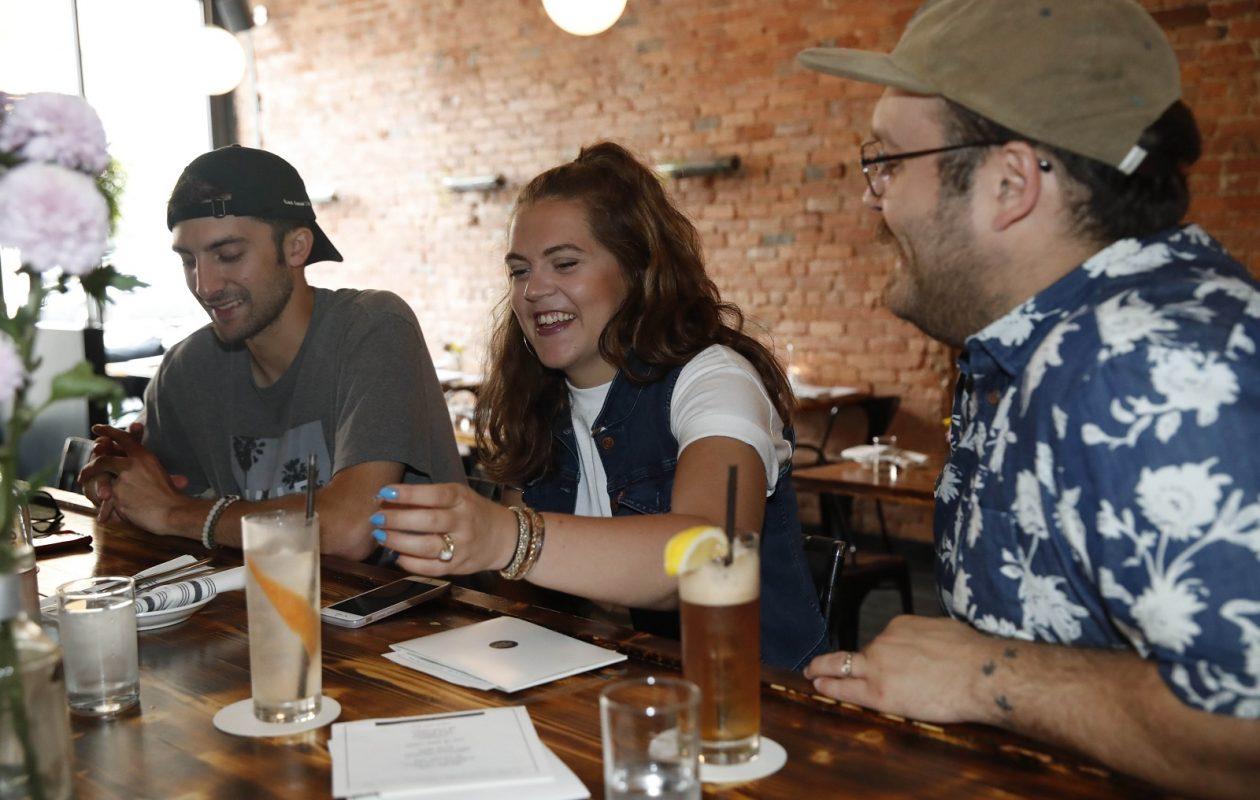 From left hanging out are Dylan Allesi, Bridget Murphy and Joe Pucciarelli, of Buffalo. (Sharon Cantillon/Buffalo News)
