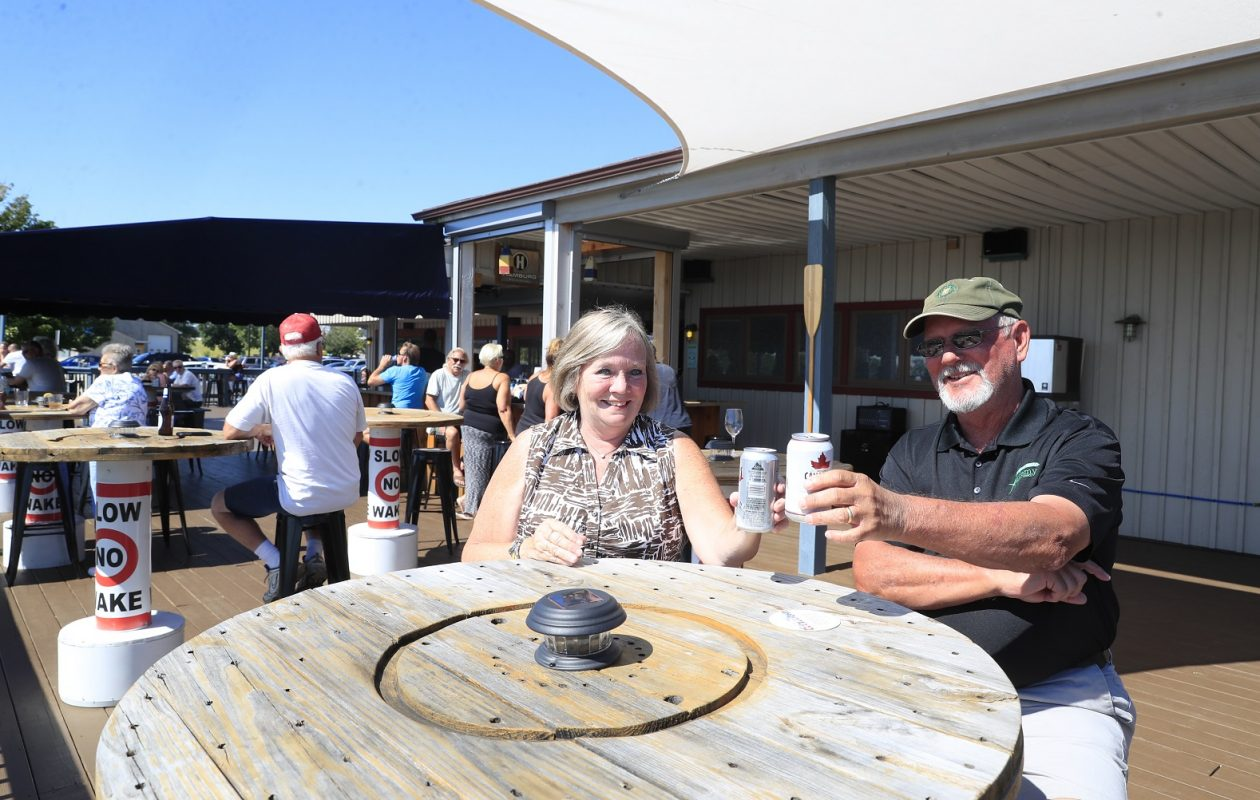 Diane and Greg Juszkiewicz enjoy a beverage at Charlie's Boat Yard. (Harry Scull Jr./Buffalo News)