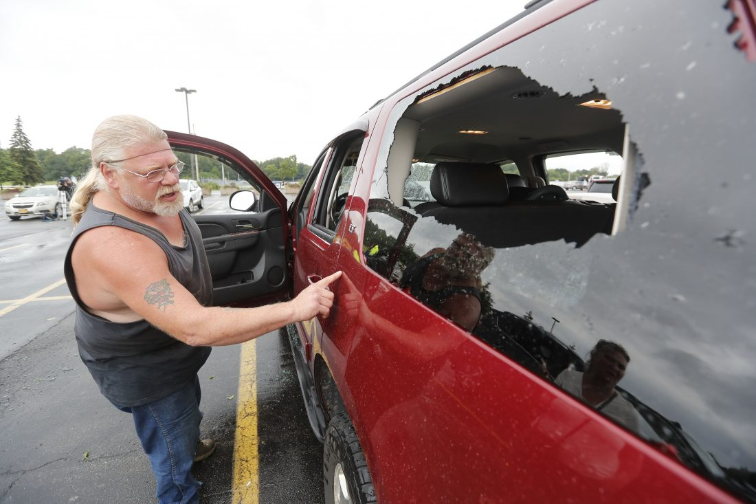 David Bodekor examines his car at the Fairgrounds in Hamburg on Thursday. (Mark Mulville/Buffalo News)