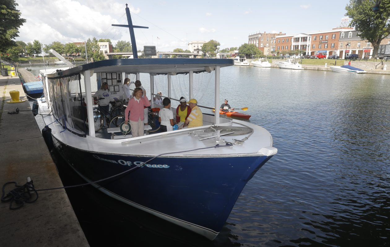 Passengers and crew get aboard the Queen of Peace ferry at the Erie Barge Canal in City of Tonawanda on Sunday.    (John Hickey/Buffalo News)