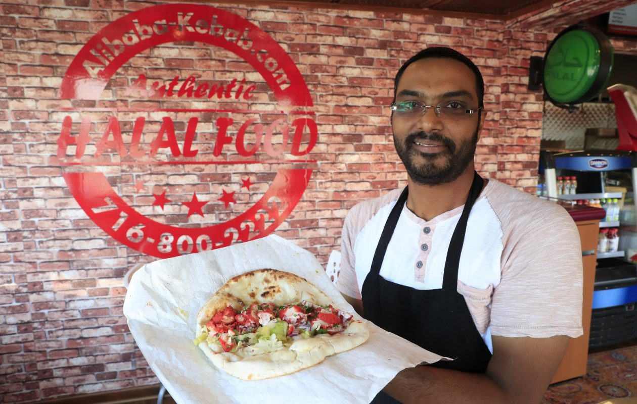 Anand Katter holds a chicken tikka masala wrap at Ali Baba Kebab. (Harry Scull Jr./Buffalo News)