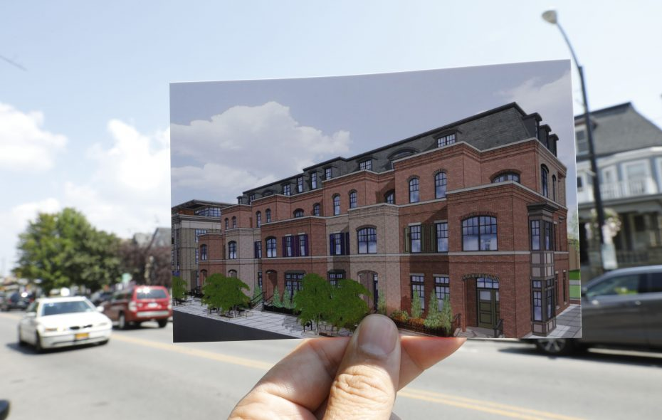 Chason Affinity sought variances for its proposal to tear down a row of houses and build a four-story condo building at the corner of Elmwood and Forest avenues. A photographic print of an architectural rendering showing the proposed development by Chason Affinity on Elmwood Avenue at Forest.  (Derek Gee/Buffalo News)