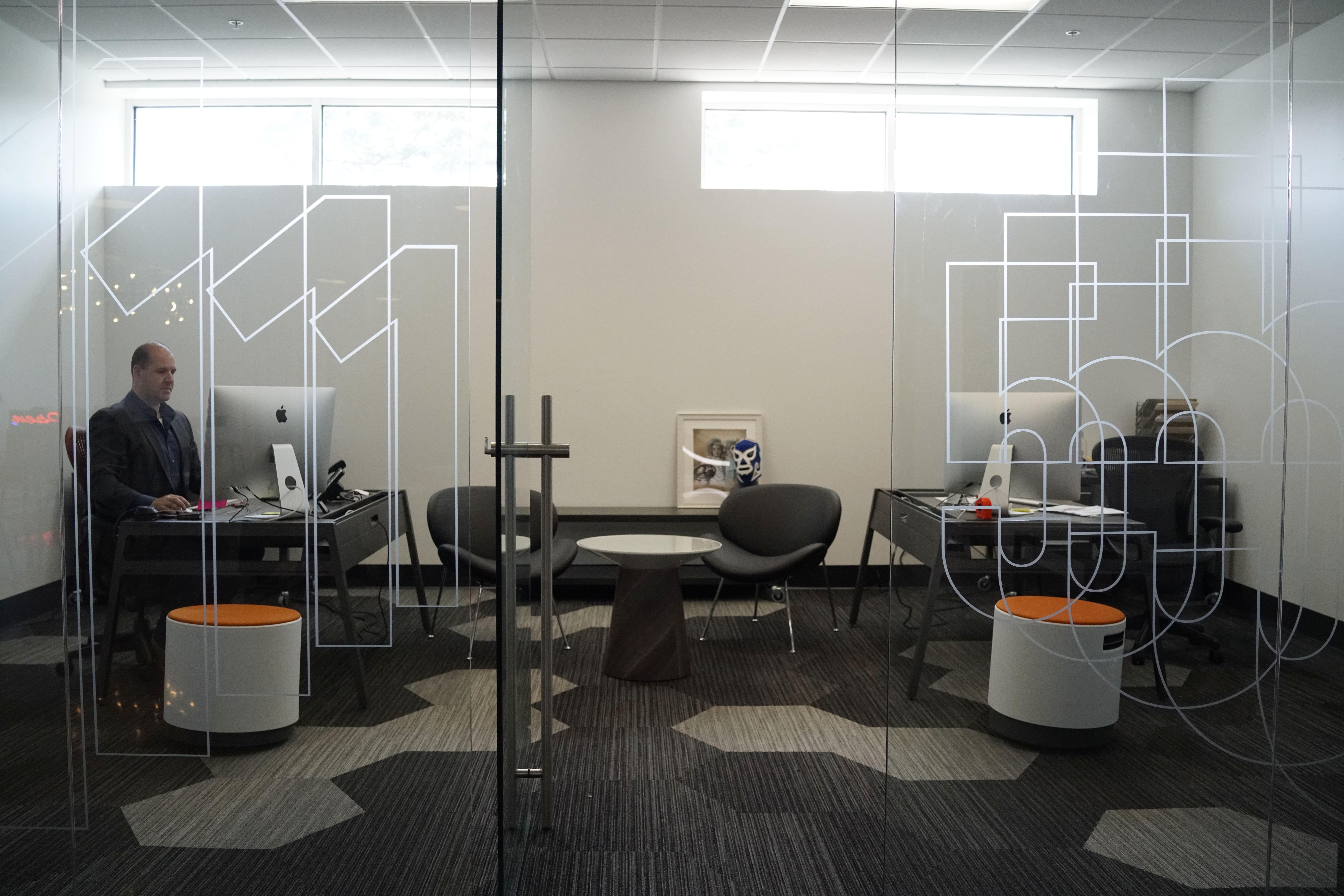 creative agency office. Zack Schneider, Partner The Creative Agency, Fifteen, Works In His Office.  (Derek Gee/Buffalo News) Agency Office
