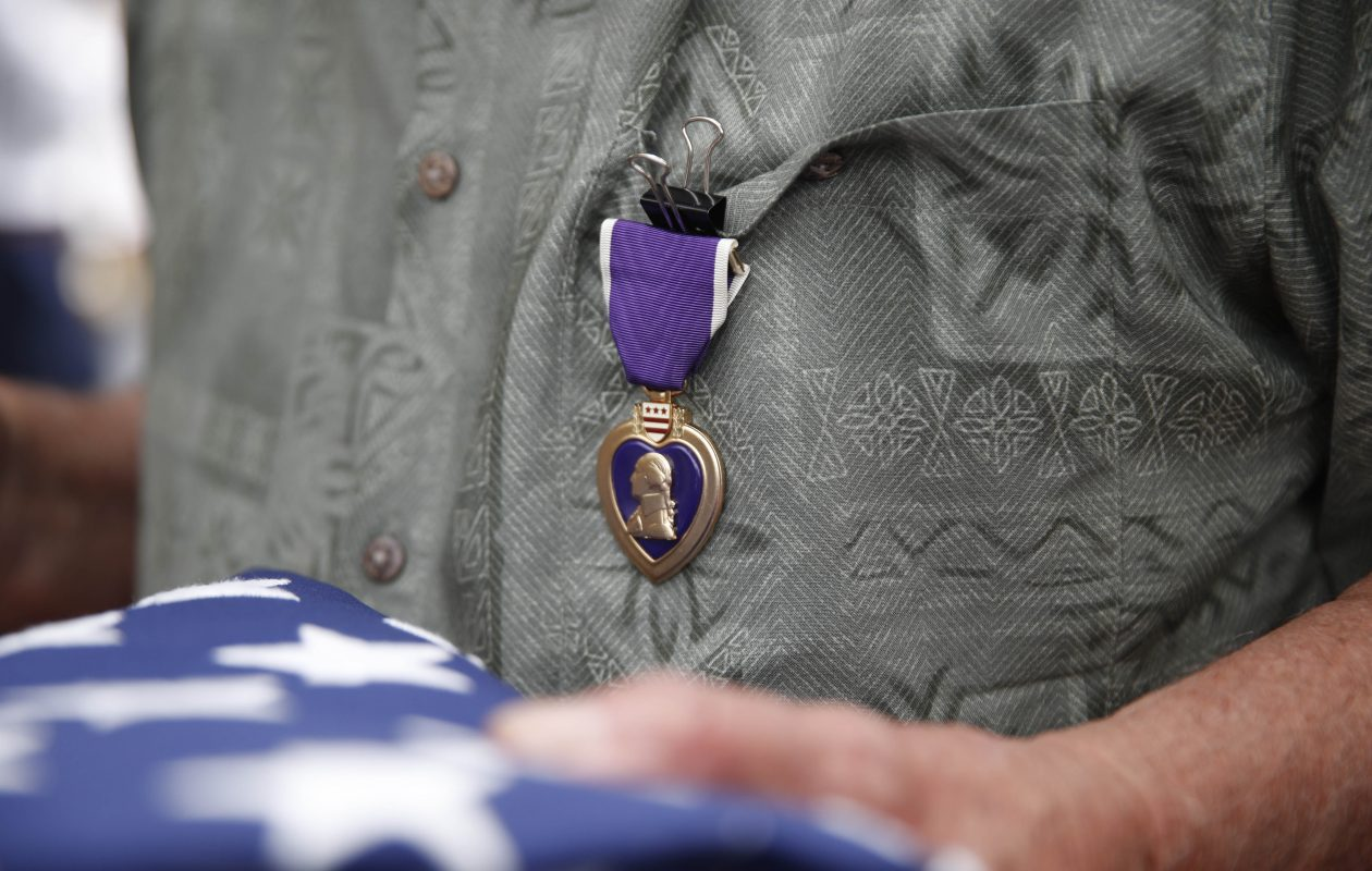 Mykola 'Nick' Shwec wears his Purple Heart. On National Purple Heart Day, Purple Hearts are awarded 50 years late to Specialist Shwec, who was wounded by shrapnel in Vietnam in 1966, and the family of the late Private Michael Licata, who was wounded in Korea during the Korean War. The ceremony took place at the Erie County Naval and Military Park, Monday, Aug. 7, 2017.  (Sharon Cantillon/Buffalo News)
