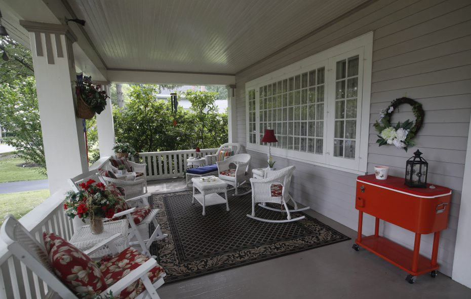 The welcoming porch is a highlight of Annette and Ted Nuding's late-19th century home. (Sharon Cantillon / Buffalo News)