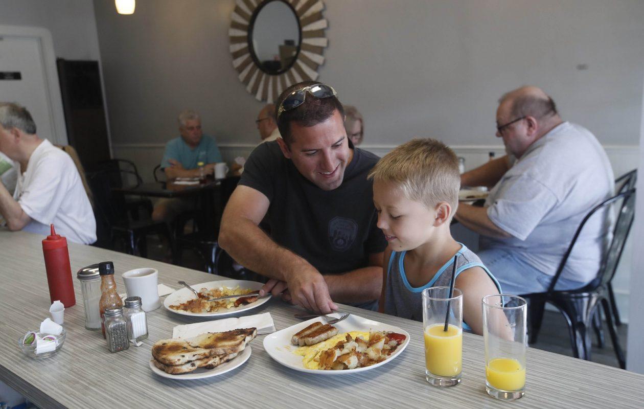 David Michaels of the Town of Tonawanda and his nephew Alex Andritz, 7, of Sarasota, Fla., have breakfast at Nick's Place Express. (Sharon Cantillon/Buffalo News)