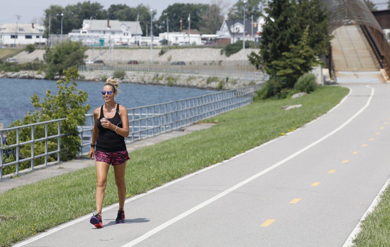 Pattie Kerl of Akron walks along the Shoreline Trail, which runs along the Niagara River in Riverside.   (Derek Gee/Buffalo News)