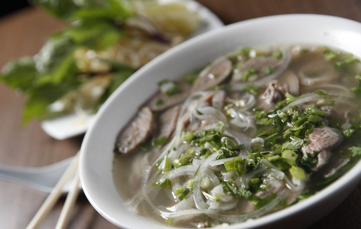 Pho Dac Biet is Cali's specialty with rice noodles, thin rare beef slices, well-done brisket, tendon, tripe, flank and sliced meatballs with additional toppings on the side. (Sharon Cantillon/Buffalo News)