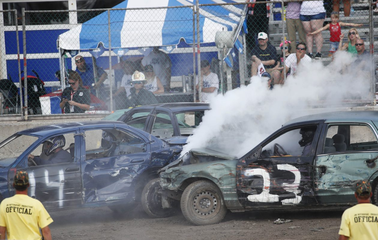 On right, Tyler Haniszewski (#14) came in second place in the first heat of the World's Largest Demolition Derby on Sunday, Aug. 20, 2017.  (Sharon Cantillon/Buffalo News)