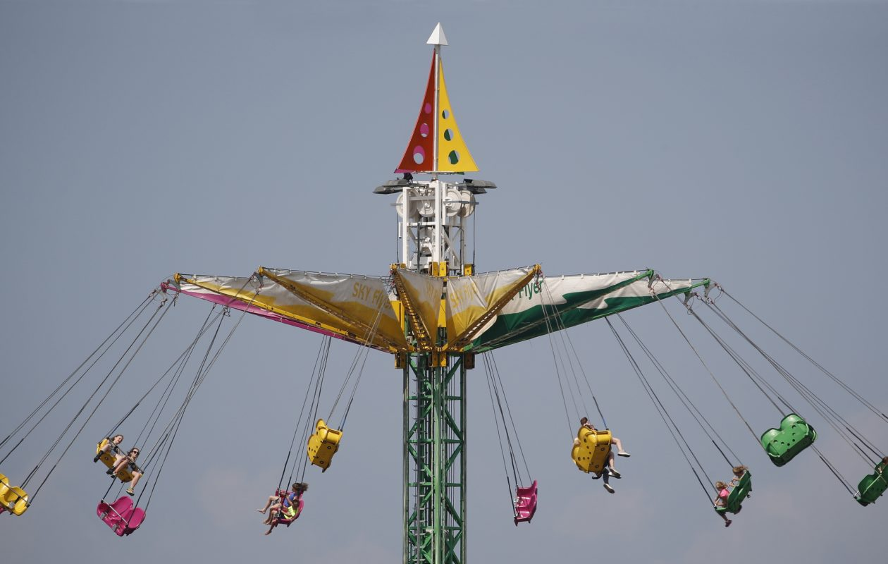 Fairgoers ride the Sky Flyer at the Erie County Fair, Sunday, Aug. 20, 2017.  (Sharon Cantillon/Buffalo News)