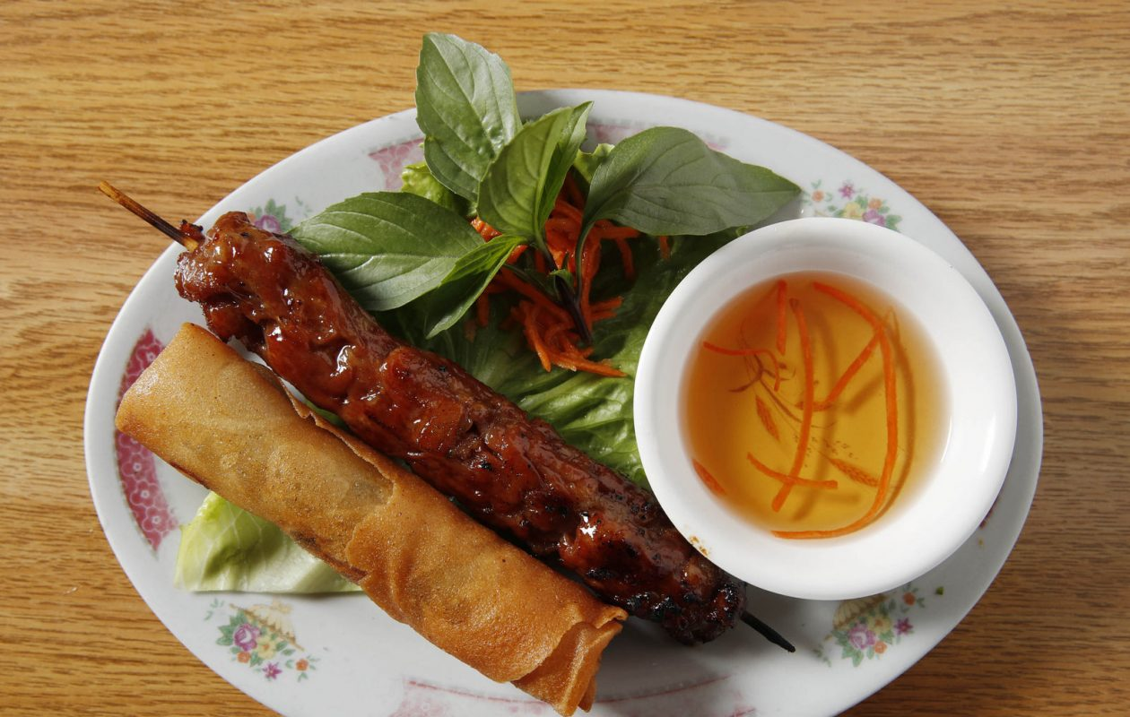 99 Fast Food at 3398 Bailey Ave. in Buffalo serves appetizers that can be served together  such as the BBQ Pork Skewer.  Behind is the Vietnamese Eggroll which is stuffed with noodles, mushrooms, carrots and pork and wrapped in rice paper and deep-fried.  The two come to $4.35. (Sharon Cantillon/Buffalo News)