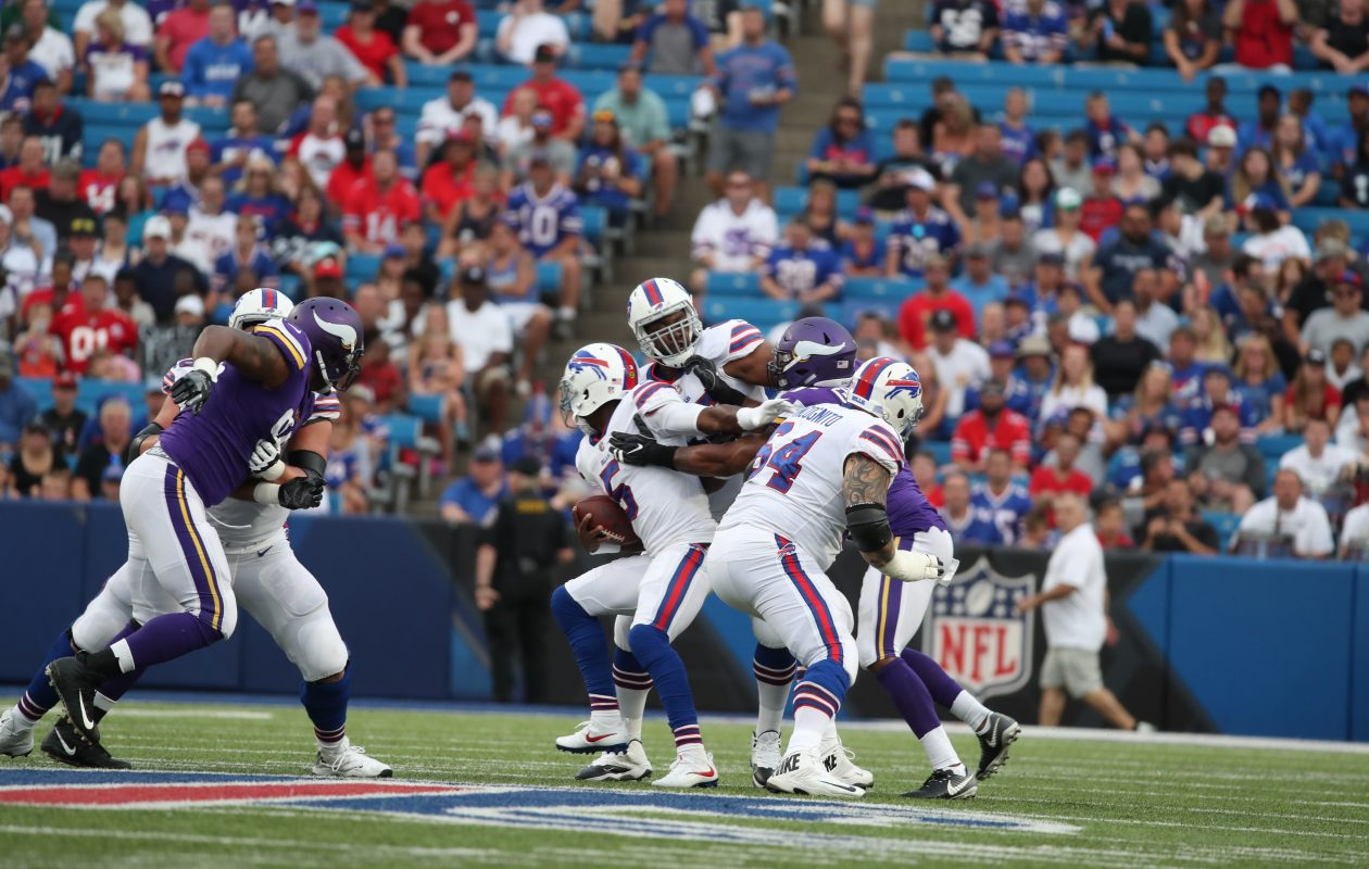 Buffalo Bills quarterback Tyrod Taylor (5) gets away from a sack in the first quarter at New Era Field in Orchard Park on Thursday, Aug. 10, 2017.  (James P. McCoy / Buffalo News)