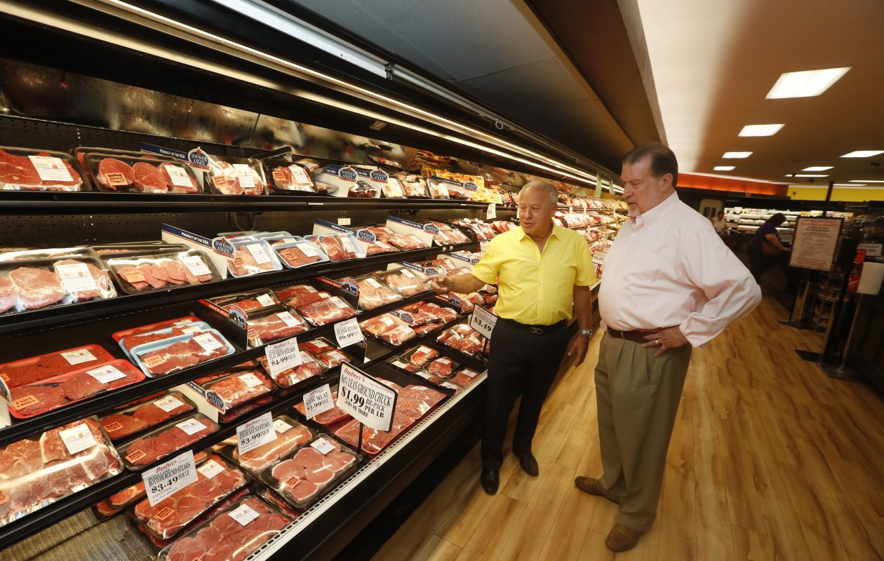 Frank Budwey, left, and Brian Kusmierski, owner of Market in the Square in West Seneca, at Budwey's Market in North Tonawanda. Budwey, a longtime local grocer, will sell Budwey's to Kusmierski.   (John Hickey/Buffalo News)