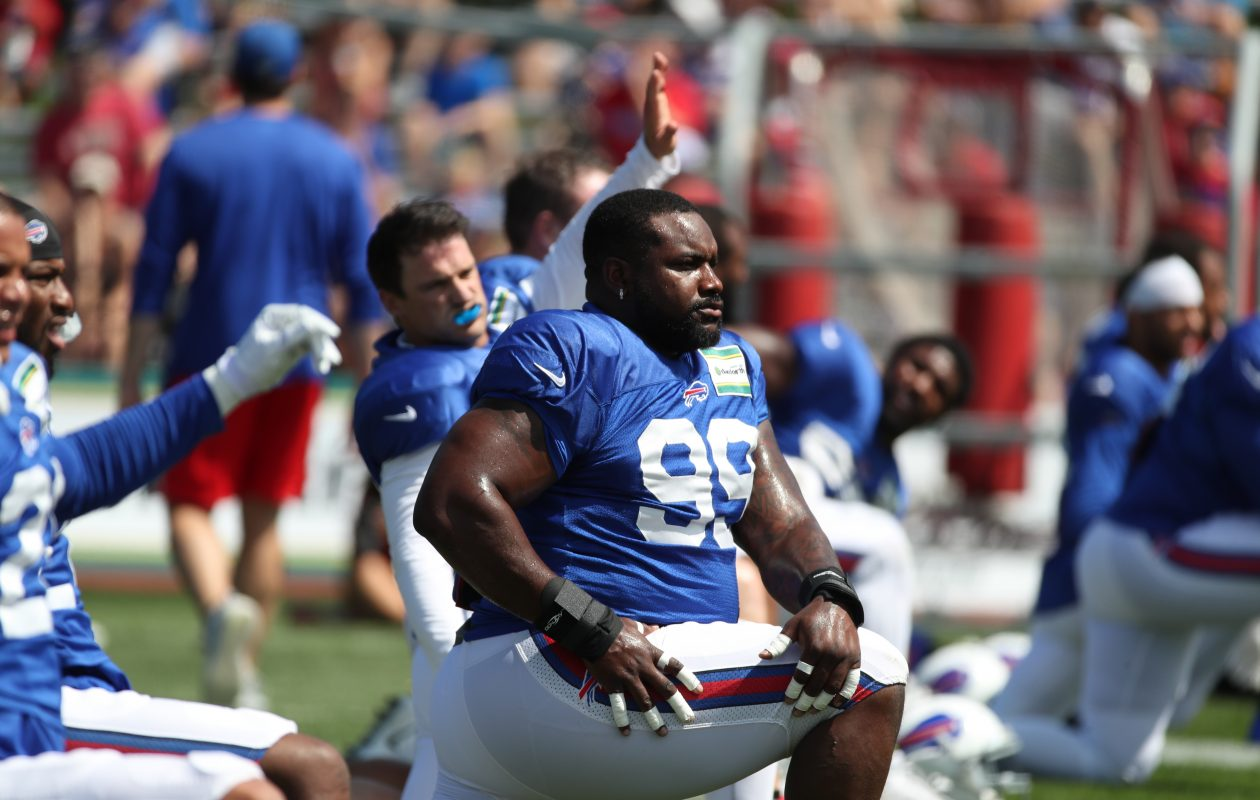 Buffalo Bills nose tackle Marcell Dareus (99) stretches during warm ups at training camp at St. John Fisher College on Sunday, Aug. 13, 2017. (James P. McCoy/Buffalo News)