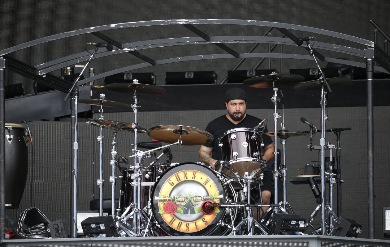 A drum technician tunes the drum set during a tour of the massive staging and production being built at New Era Field in Orchard Park as part of the big Guns N' Roses concert. This was on Tuesday, Aug. 15, 2017.  (Robert Kirkham/Buffalo News)