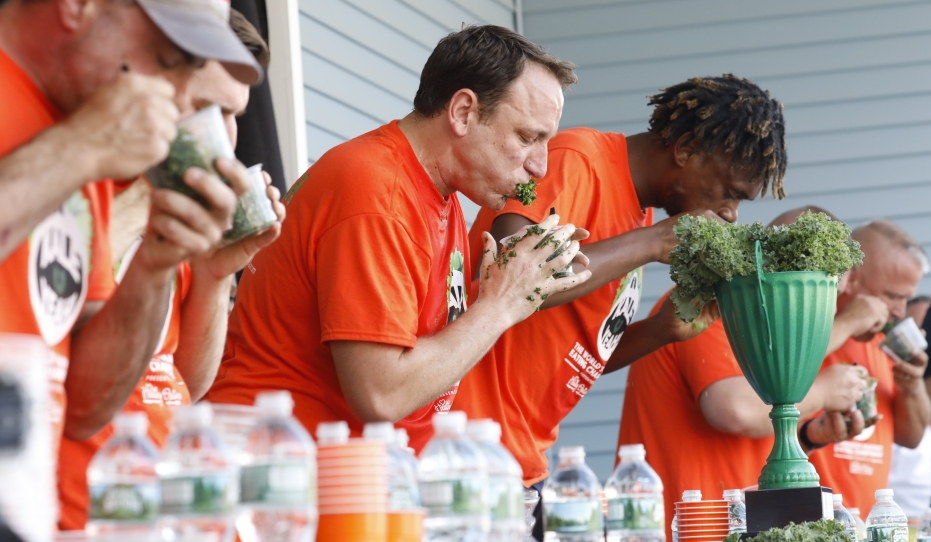 Competitive eater Joey 'Jaws' Chestnut and winner Gideon Oji compete in the second annual Kale Yeah! kale eating competition hosted by Independent Health at the Erie County Fair, Sunday, Aug. 13, 2017.   (Derek Gee/Buffalo News)
