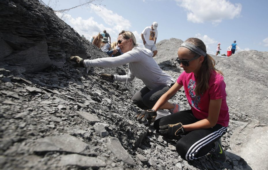 Kathy Smith of Lancaster and her daughter Taylor scour for fossils. Smith is an teaches earth science at Amherst High School and comes to Penn Dixie every year to collect fossils to give to her students on the first day of class in September. (Sharon Cantillon/Buffalo News)