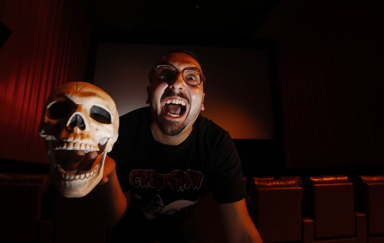 Peter Vullo serves as the programmer and host of the 'Thursday Night Terrors' film series at Dipson Amherst Theatre. (Sharon Cantillon/Buffalo News)