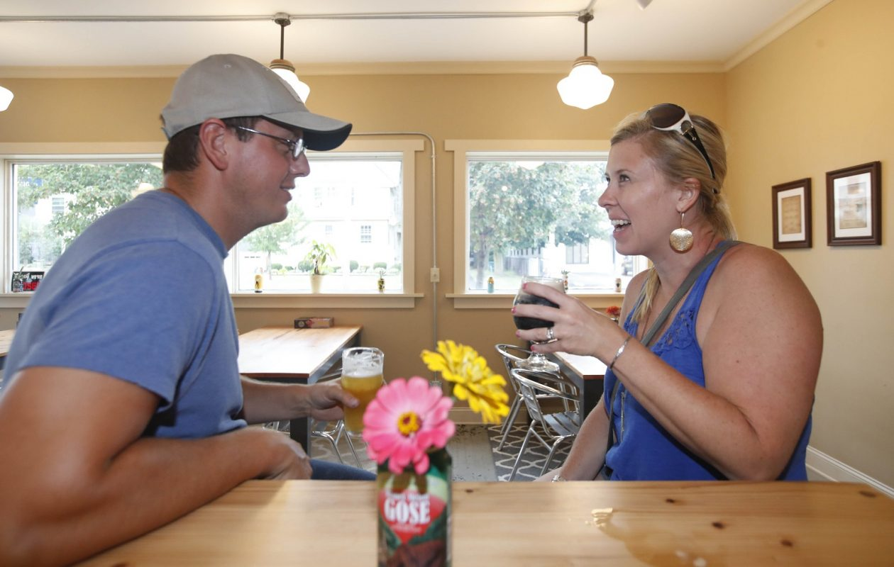 Ed and Kristen Helling of Angola enjoy a couple of beers at Hamm & Fattey's Beer Co. (Sharon Cantillon/Buffalo News)