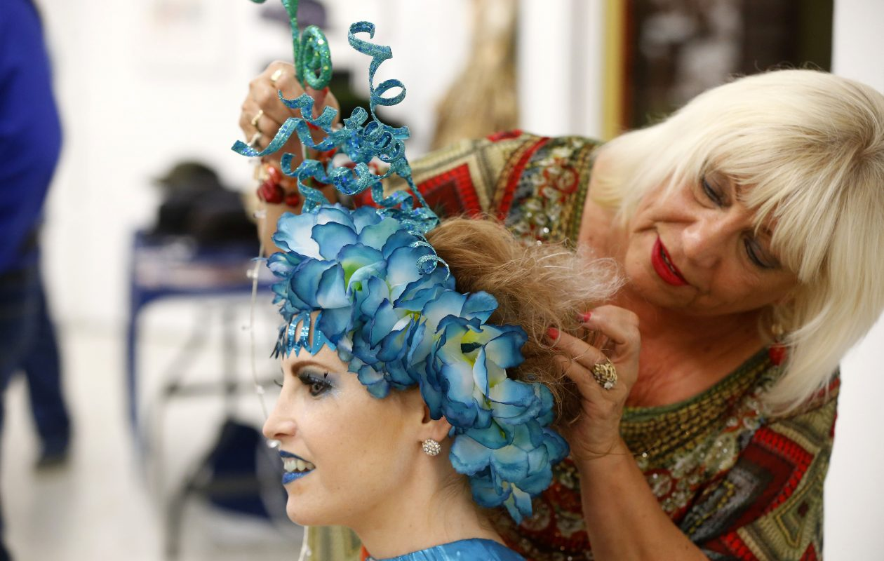 Makeup artist and hairstylist Josie Young puts the finishing touches on model Sherri Lyn Litz during the opening of the new show, 'The Art of Fashion,' which will be open daily through Oct. 8 in the Niagara Arts and Cultural Center at Pine Avenue and Portage Road.        (Mark Mulville/Buffalo News)