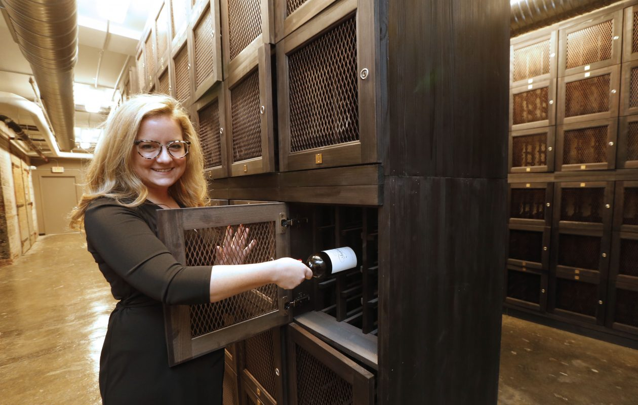 Winkler & Samules sommedlier Melissa Winkler shows the wine locker room under the Seneca Street store. (Robert Kirkham/Buffalo News)