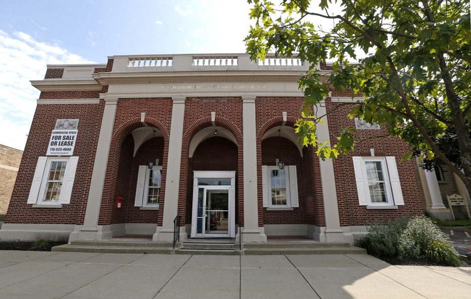Built in 1925 for the Bank of East Aurora, the two-story branch features a brick facade, columned entry and rooftop balcony, as well as a full basement.  (Robert Kirkham/Buffalo News)