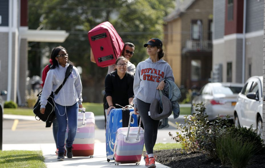 Students from left to right; Cindy Rodriguez, Oasis McBride, James Foxworth, Lisa Lin, and Kaylyn Padilla carry their belongings to their room on move-in day at Monarch 716  Saturday. (Mark Mulville/Buffalo News)