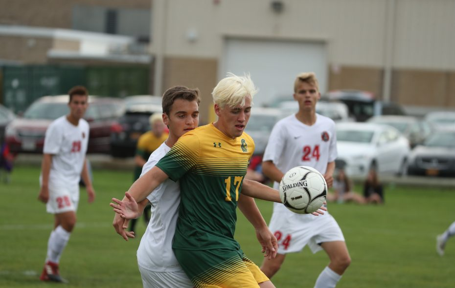 Williamsville North's Blake Ferrell beats Lancaster's Pat Morin for the ball in the first half Tuesday. (James P. McCoy/Buffalo News)