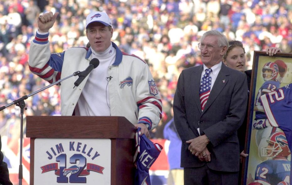 Jim Kelly addresses the crowd at Rich Stadium the day his No. 12 was retired by the Buffalo Bills on Nov. 18, 2001, as his father, Joe, looks on. (John Hickey/News file photo)
