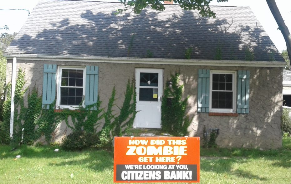 """This vacant house at 8220 Frontier Ave., seen on Aug. 25, 2017, is one of the Citizens Bank """"zombie homes"""" posted by Niagara Falls workers, which led to a successful lawsuit against the bank. (Thomas J. Prohaska/Buffalo News)"""