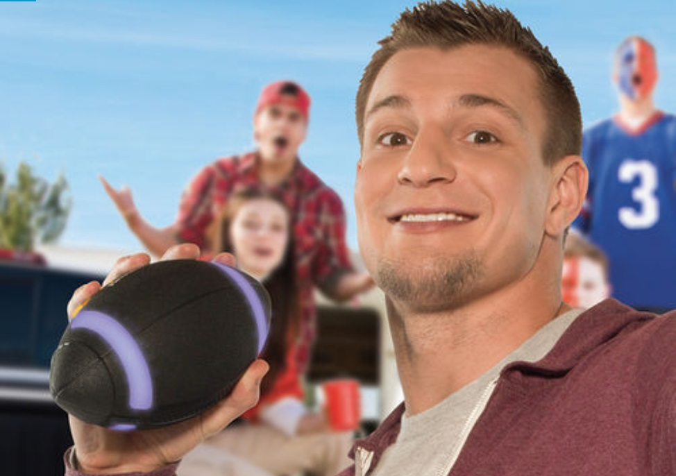 Image of Rob Gronkowski holding the Gronk Ball, a new product in collaboration with Brookstone. (via Brookstone)