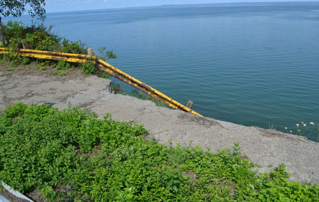 The old guardrail hangs off the edge of a roughly 40 foot cliff on Old Lake Shore Road in the town of Hamburg. (Credit: Erie County Legislator Lynne Dixon)