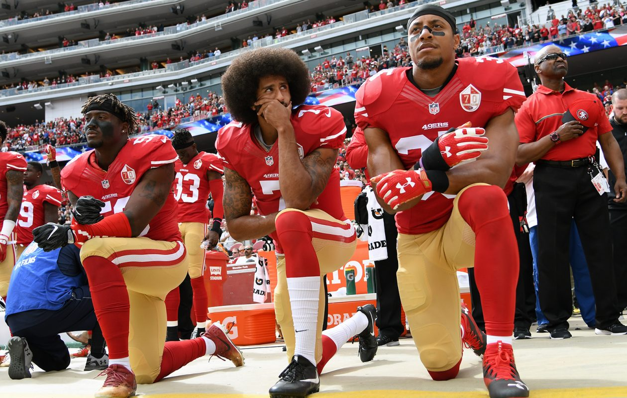 From left, Eli Harold, Colin Kaepernick and Eric Reid of the San Francisco 49ers kneel on the sideline during the anthem before the Oct. 2, 2016, game against the Dallas Cowboys in Santa Clara, California. (Thearon W. Henderson/Getty Images)