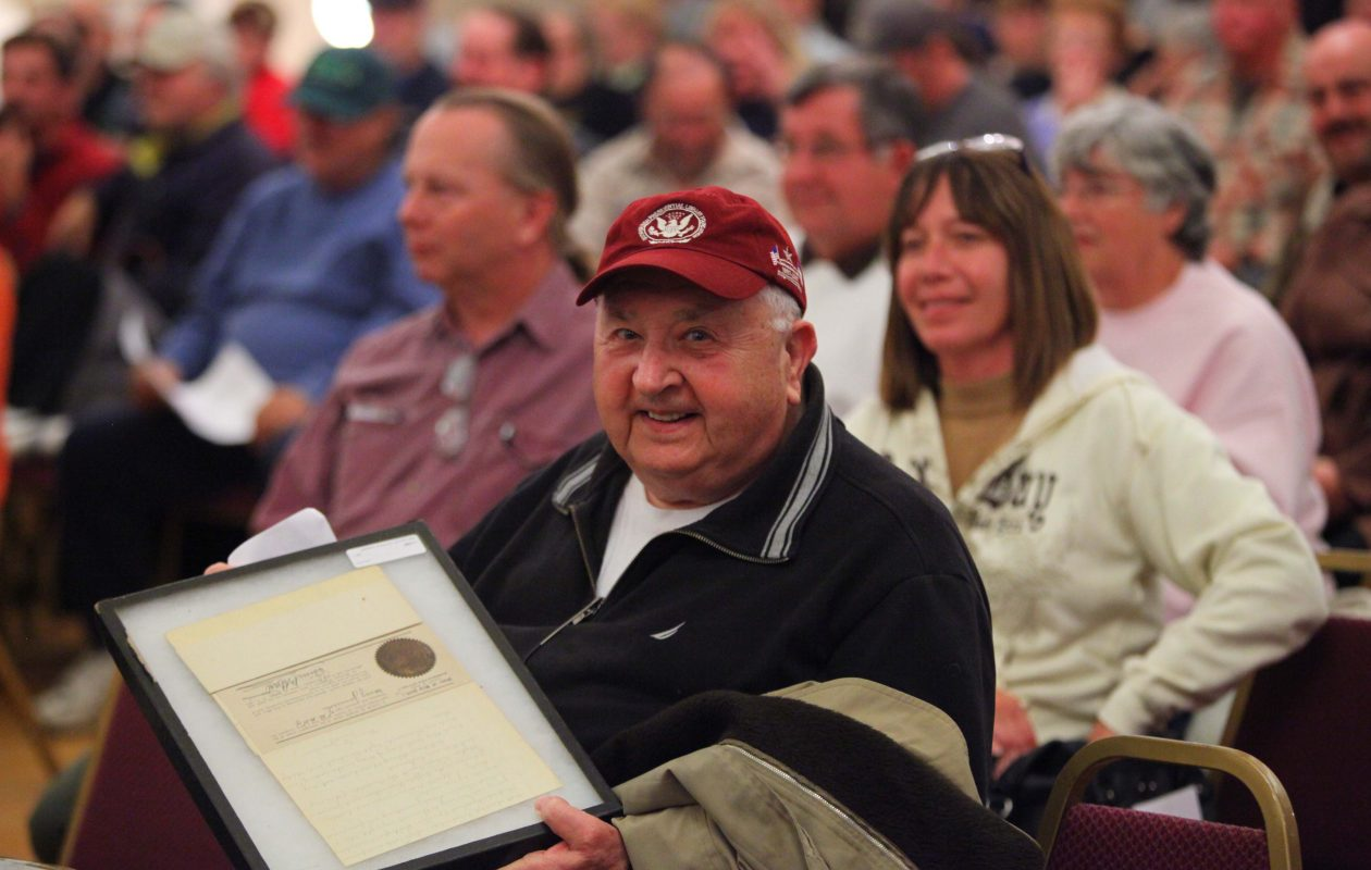 Eugene Musial , who spent his life collecting Buffalo's earliest publications before his death in 2012, shows off his prize, the will of Mary Jemison at a 2010 auction.  (News file photo)
