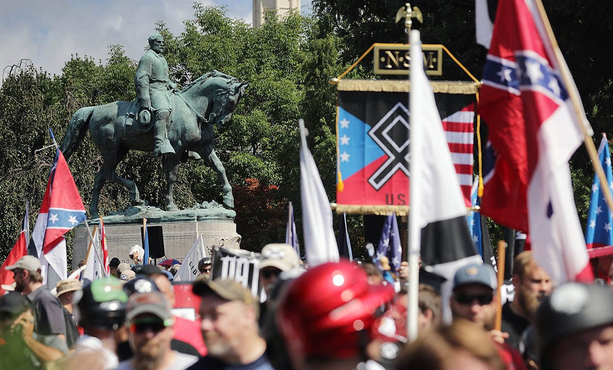 The Daily Stormer's incendiary coverage of protests in Charlottesville, Va., got the neo-Nazi news source kicked off both GoDaddy and Google.  (Chip Somodevilla/Getty Images)