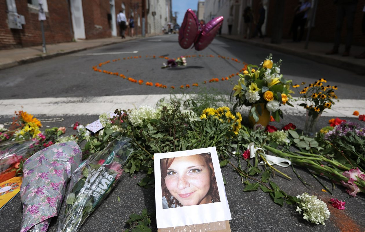 Flowers surround a photo of 32-year-old Heather Heyer, who was killed when a car plowed into a crowd of people protesting against the white supremacist Unite the Right rally, August 13, 2017 in Charlottesville, Virginia.  (Getty Images)