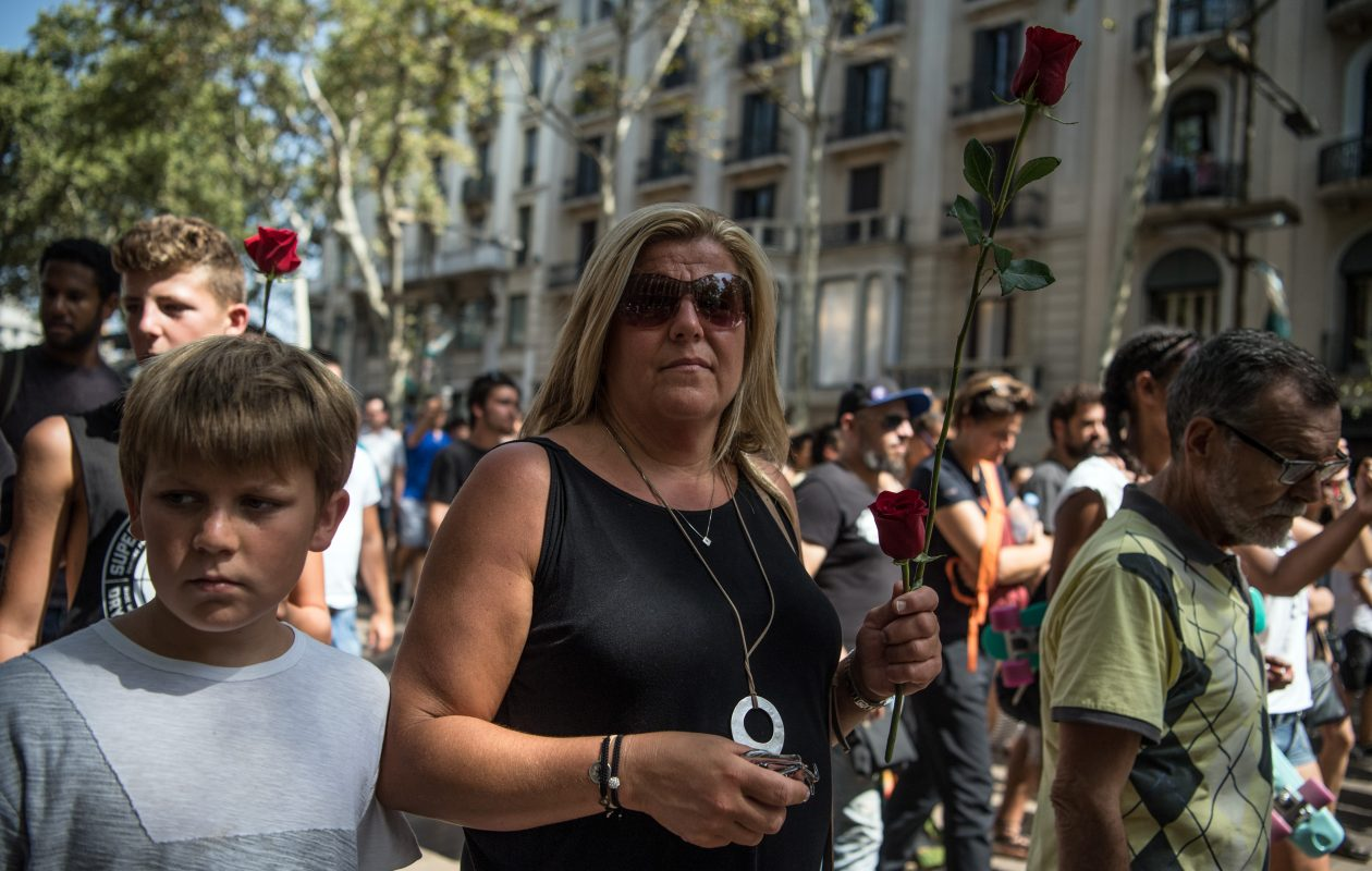 A woman holds a rose as she walks along Las Ramblas after observing a minute's silence following Thursday's terror attack in Barcelona. (Photo by Carl Court/Getty Images)