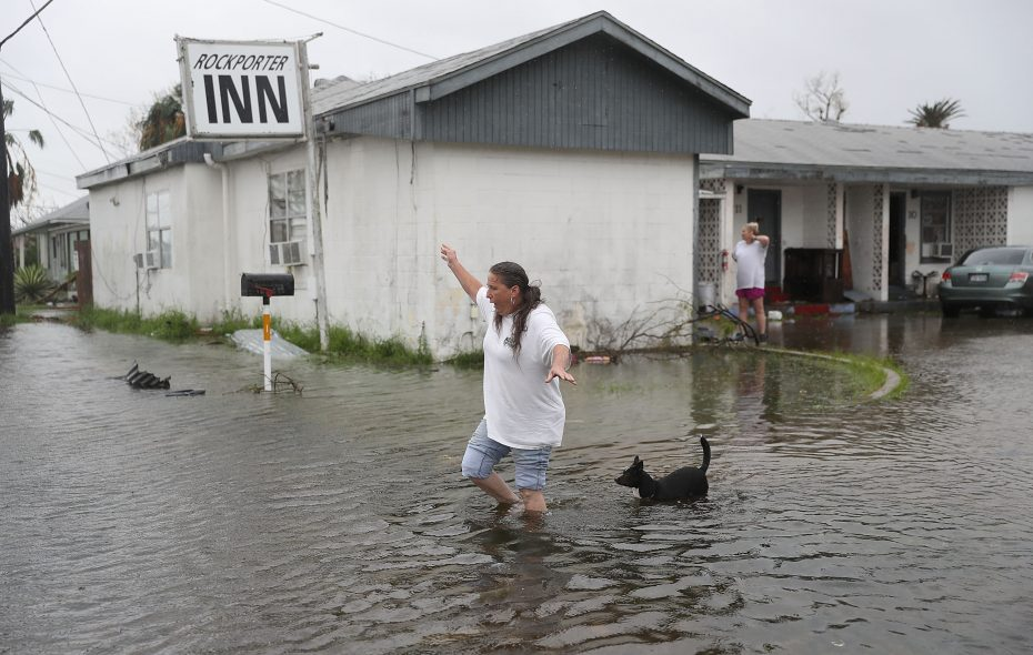 Valerie Brown walks through a flooded area after leaving the apartment that she rodre out Hurricane Harvey in on August 26, 2017 in Rockport, Texas.   (Getty Image)