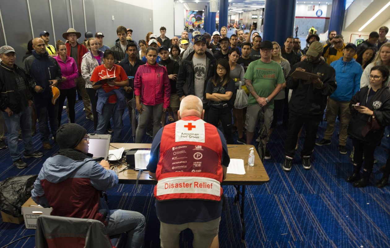 Volunteers get a briefing at the George Brown Convention Center that has been turned into a shelter run by the American Red Cross to house victims of the high water from Hurricane Harvey on Aug. 28, 2017, in Houston. The American Red Cross is one of the BBB Accredited Charities raising moneyfor Hurricane Harvey victims.  (Photo by Erich Schlegel/Getty Images)