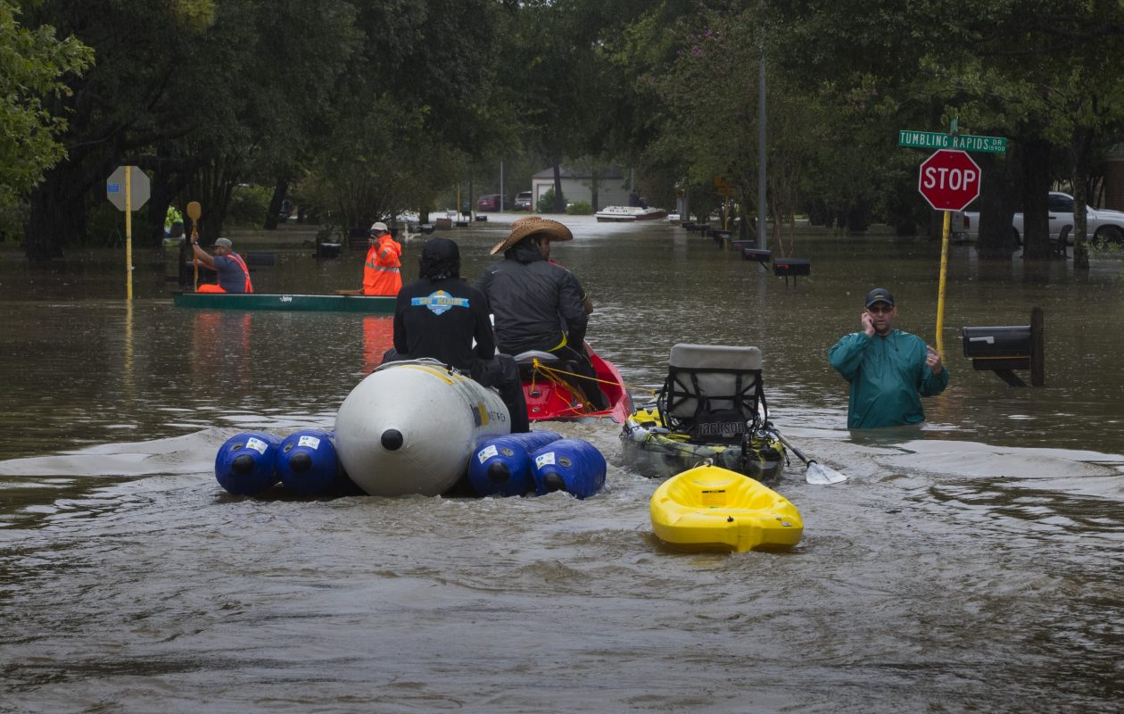 Rescuers go house-to-house checking for anyone that may need rescue in the Bear Creek neighborhood of Houston Tuesday after it was flooded by heavy rains from Hurricane Harvey. (Photo by Erich Schlegel/Getty Images)