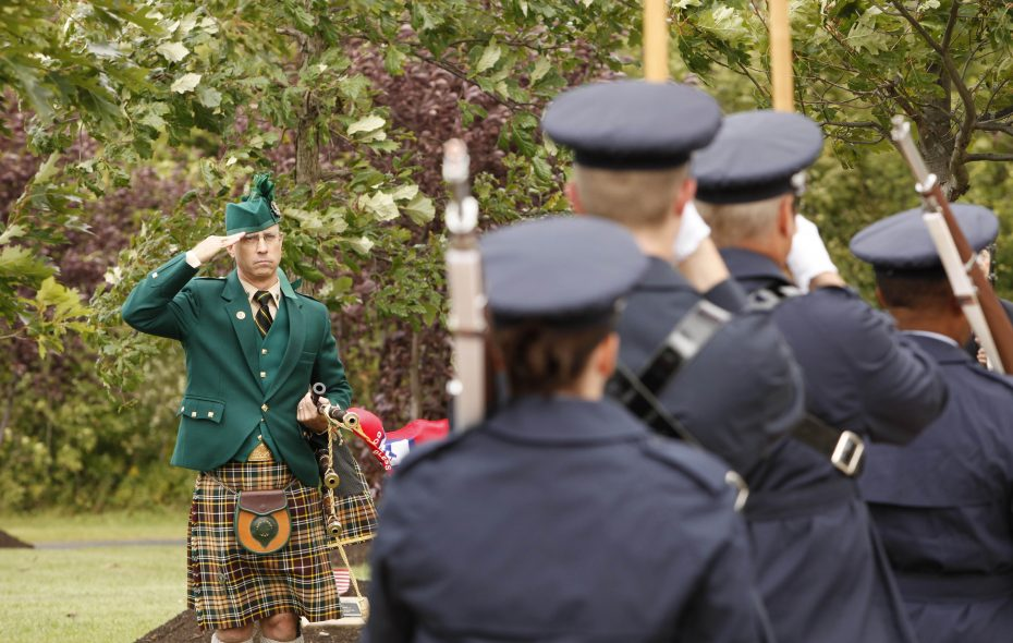 Bagpiper Danne Farrell salutes as a color guard passes during a Sept. 11 Ceremony of Remembrance at the Amherst Memorial Hill Grove in Amherst, N.Y. on Sept. 8, 2010.  {Photo by Derek Gee / Buffalo News}