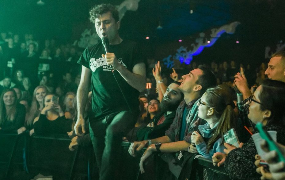 Max Kerman jumps off stage to interact with his fans in Town Ballroom in a December 2016 concert. (Don Nieman/Special to The News)