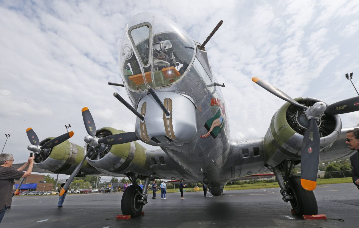 The 'Madras Maiden,' a restored WWII B-17 bomber plane, sits on the tarmac at Buffalo Niagara International Airport on Aug. 7, 2017. A similar plane will be seen in local skies Thursday. (Robert Kirkham/Buffalo News)