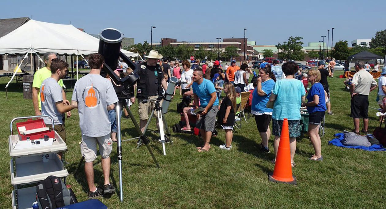 Stargazers at SUNY Buffalo State get ready to look at the sun through telescopes set up in anticipation of the total solar eclipse. (John Hickey/Buffalo News)