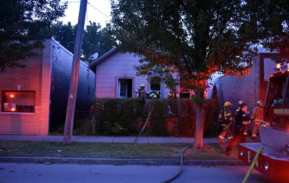 Fire investigators at the scene of Thursday's house fire on Niagara Street in Niagara Falls. (Larry Kensinger/Special to The Buffalo News)