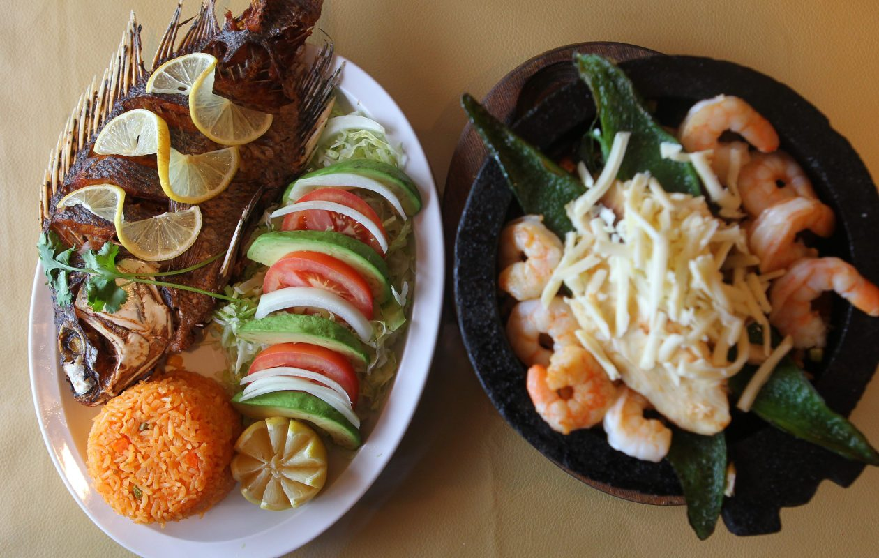 Molcajete and whole fried fish at El Ranchito in Clarence. (Mark Mulville/Buffalo News)