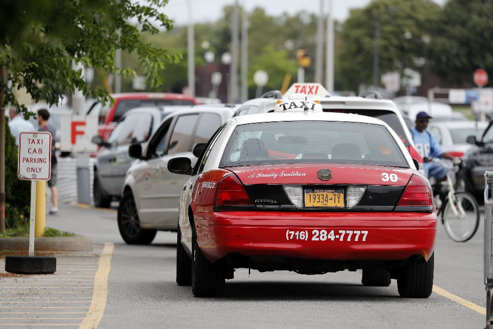 Taxis line up and hope  for fares at the Tops on Portage Road in Niagara Falls. Despite working near a tourist attraction, most of their business comes from local residents. (Mark Mulville/Buffalo News)