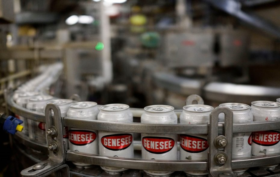 Cans of Genesee speed out of the canning line on a conveyor belt at Genesee Brewing Co. (Derek Gee/ Buffalo News)