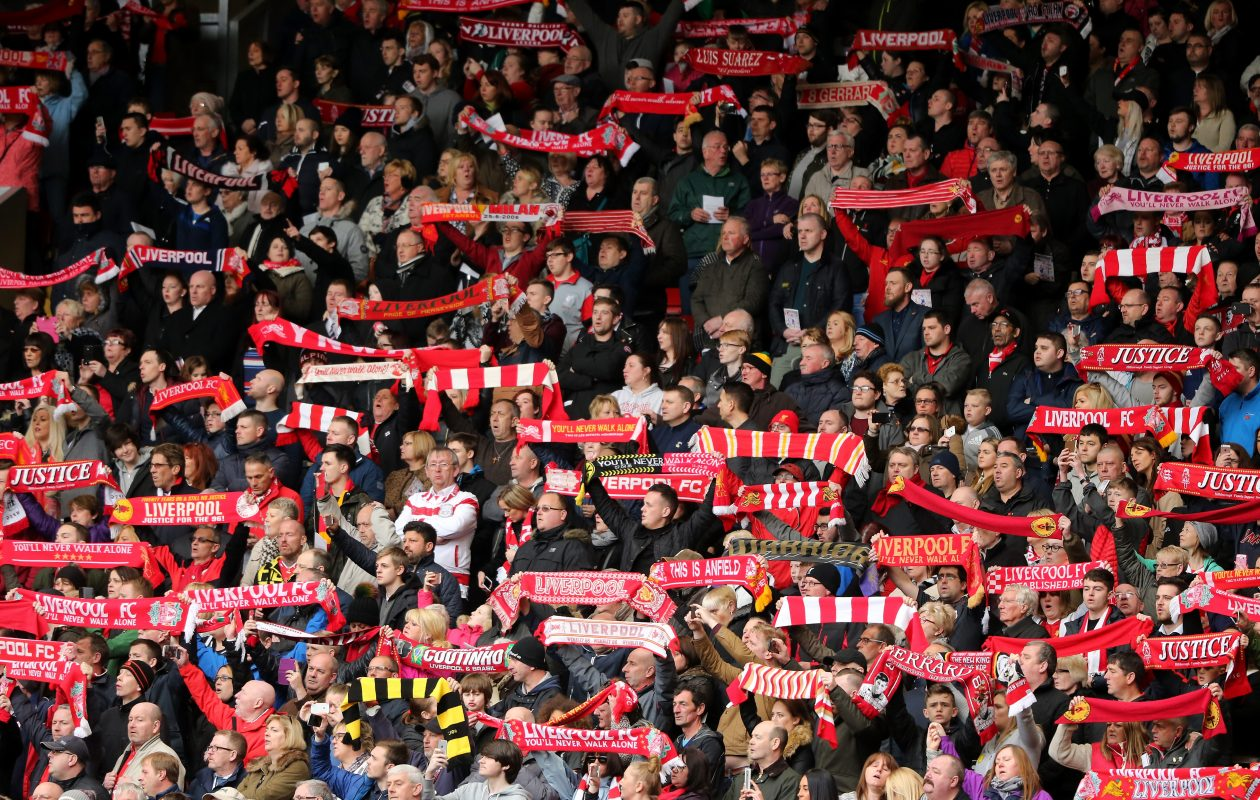 Liverpool fans sing 'You'll Never Walk Alone' at Anfield, the club's famous stadium. (Christopher Furlong/Getty Images)