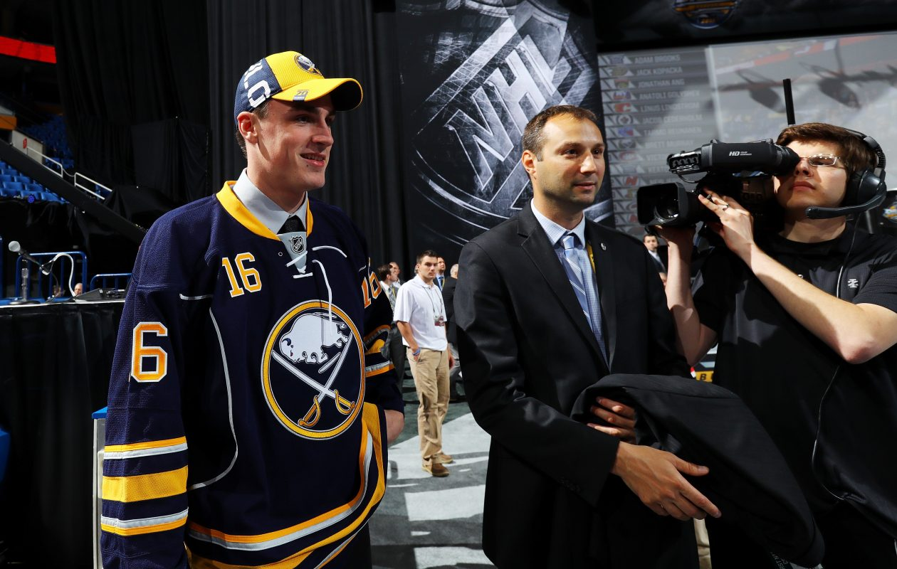 Chris Bandura, next to Sabres 2016 draft pick Brett Murray, serves as a liaison between players and media. (Getty Images)